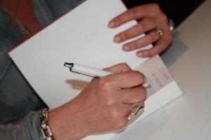 Signerar händer